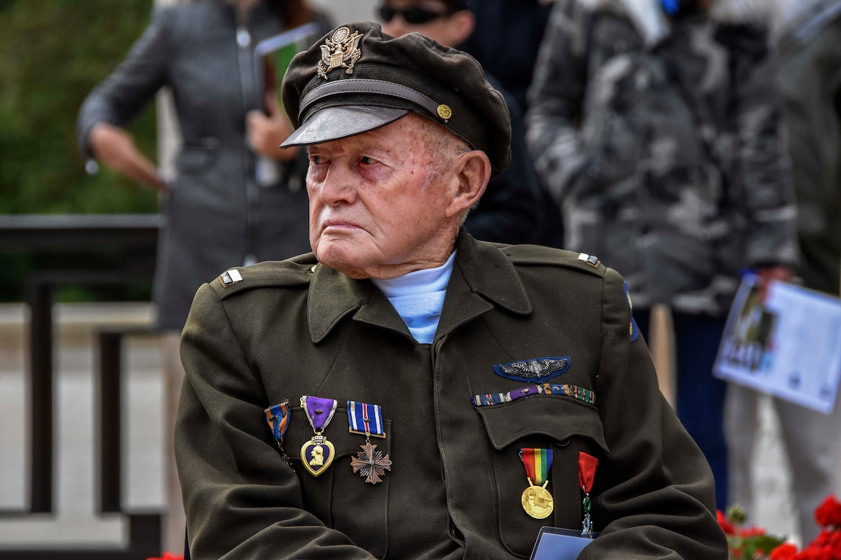 A veteran is honored during the 74th D-Day ceremony.
