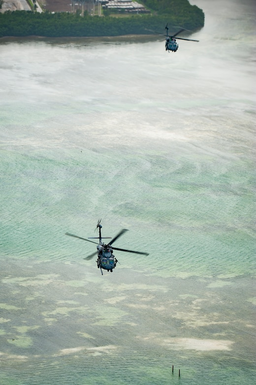 Air Force Reserve Citizen Airmen from the 301st Rescue Squadron out of Patrick Air Force Base in Cocoa Beach, Florida fly near Miami Beach aboard an HH-60G Pave Hawk helicopter on May 25th, 2018 during a practice run for the 2nd annual Salute to American Heroes Air and Sea Show over Miami Beach, Florida.  This two-day event showcases military fighter jets and other aircraft and equipment from all branches of the United States military in observance of Memorial Day, honoring servicemembers who have made the ultimate sacrifice. (U.S. Air Force photo/Staff Sgt. Jared Trimarchi)