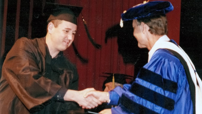 U.S. Air Force Chief Master Sgt. Doug Turner receives his bachelor's degree. (Courtesy Photo)