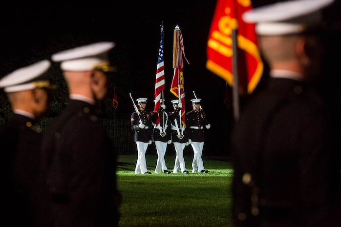 Marines with the U.S. Marine Corps Color Guard march the National Ensign and U.S. Marine Corps Battle Colors onto the parade deck during the Friday Evening Parade at Marine Barracks Washington, June 1, 2018.