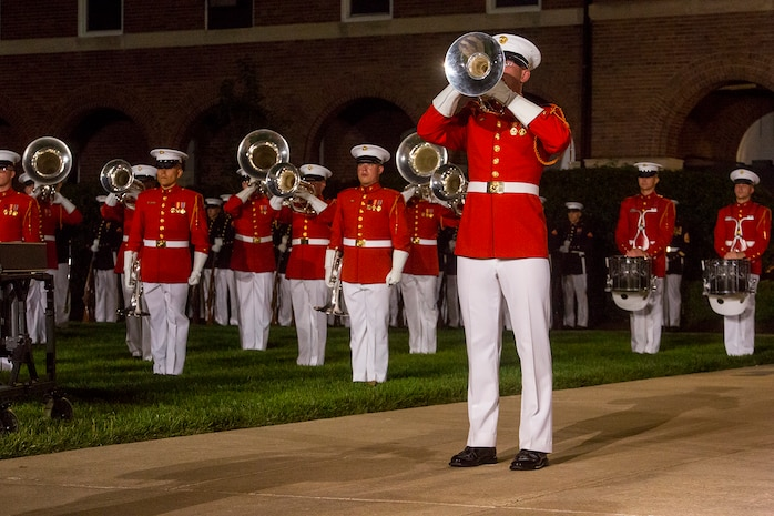 "Corporal Brice Bach, bugler, ""The Commandant's Own"" U.S. Marine Drum & Bugle Corps, performs a solo during the Friday Evening Parade at Marine Barracks Washington, June 1, 2018."