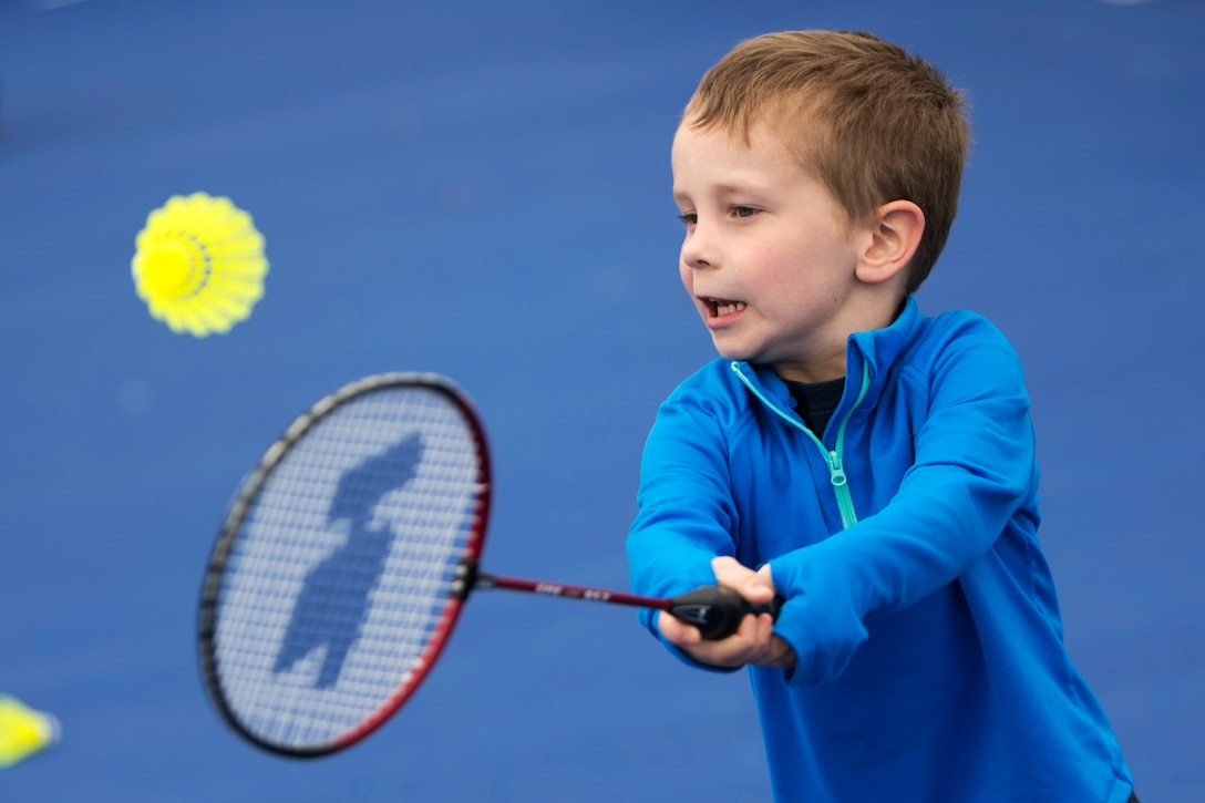 A boy plays in a badminton game.