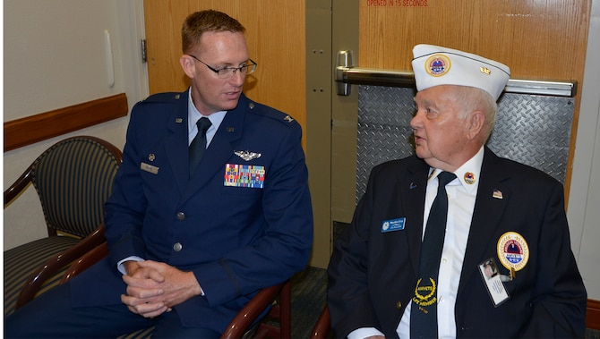 Col. Gregory Krane, 101st Air Operations Group commander, 601st Air Operations Center, speaks with Marlin Coy, AMVETS Department of Florida Representative to the Clifford Chester Sims State Veterans' Nursing Home, May 28, prior to  Krane's Memorial Day commemoration remarks there. During his remarks, Krane talked about the residents' invaluable sacrifice to service, and then stayed after to visit with the residents and personally extend his thanks to them. (Air Force Photo by Mary McHale)