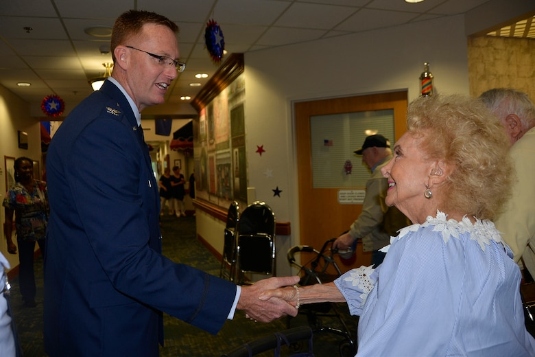 Col. Gregory Krane, 101st Air Operations Group commander, 601st Air Operations Center, greets Maxine Mann, resident of the Clifford Chester Sims State Veterans' Nursing Home, May 28, following his Memorial Day commemoration remarks there. During his remarks, Krane talked about the residents' invaluable sacrifice to service, and then stayed after to visit with the residents and personally extend his thanks to them. (Air Force Photo by Mary McHale)