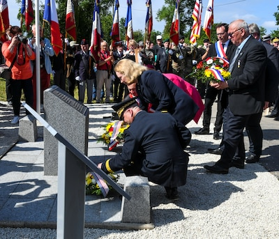 U.S. Army Europe Commanding General Lt. Gen. Christopher Cavoli, Susan Eisenhower, and community leaders lay wreaths at the base of the Eisenhower Monument in Tournieres, France.