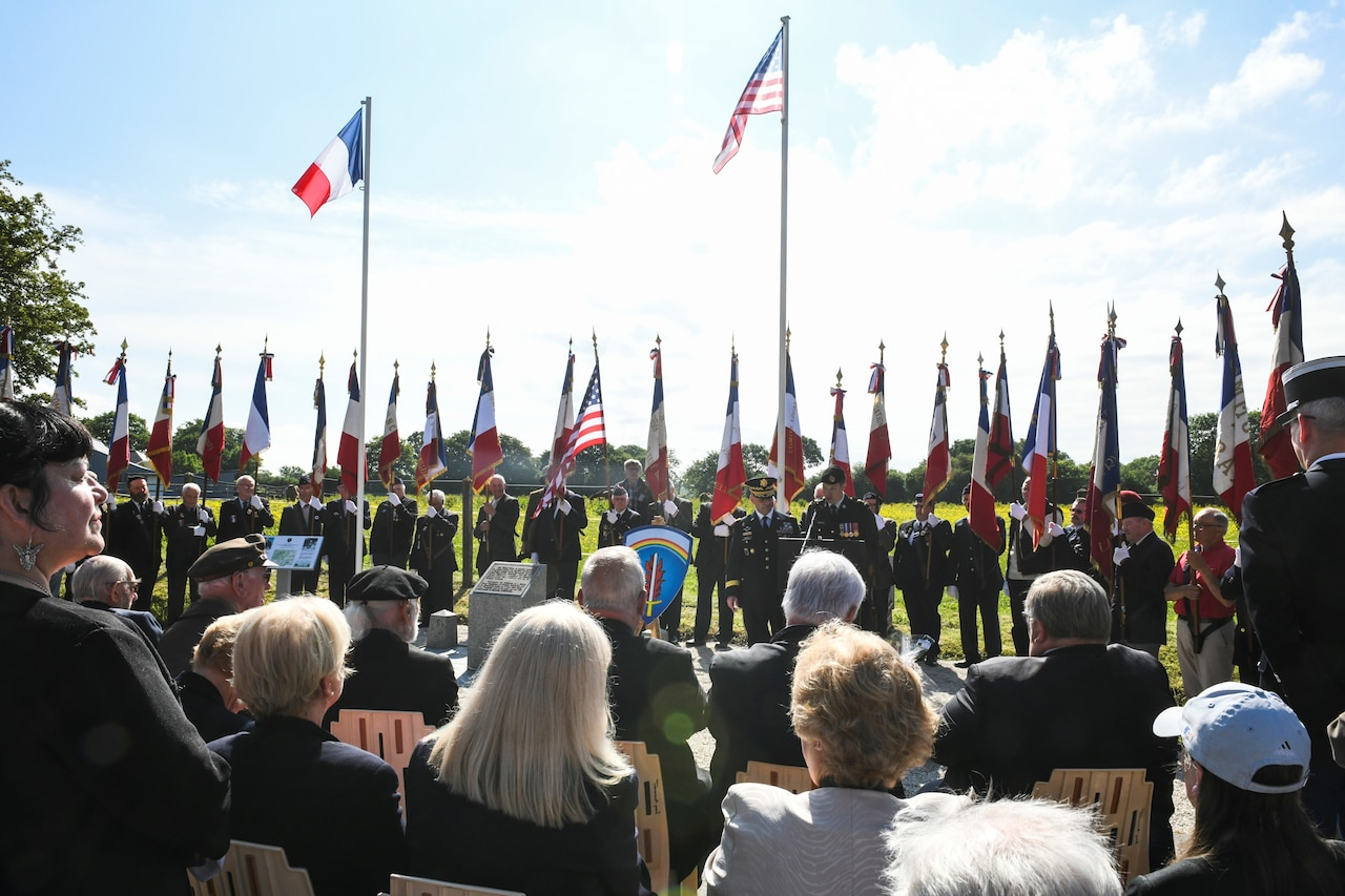 U.S Army Europe soldiers, World War II veterans, local leaders and residents gather at the General Eisenhower Monument in Tournieres, France.
