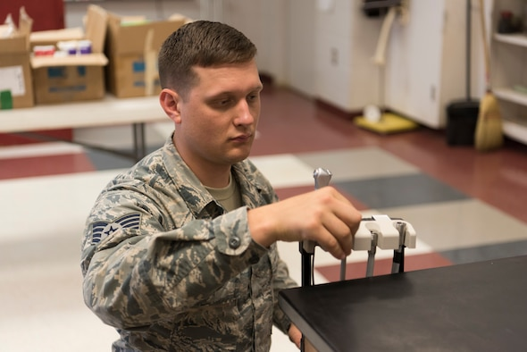 Staff Sgt. Jaron Franks, an Air National Guard biomedical equipment technician from the 187th Fighter Wing CERFP in Montgomery, Ala., ops checks and repairs dental equipment during the Alabama Wellness Innovative Readiness Training Mission on June 2, 2018 at Thomasville High School in Thomasville, Ala. Air Guardsmen from Alabama and Wisconsin were part of the joint force participating in the two-week training that provided no-cost health care to the citizens of lower Alabama. (US Air National Guard photo by Staff Sgt. Jared Rand).