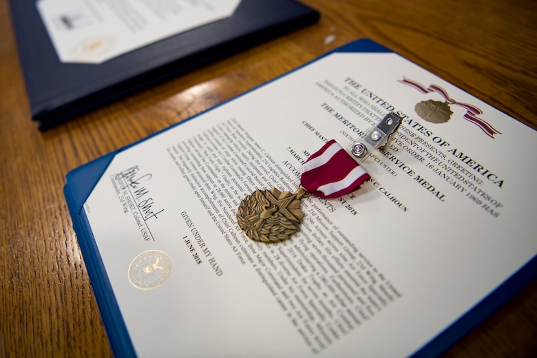 A Meritorious Service Metal awarded to Chief Master Sgt. Jim Calhoun, 23d Logistics Readiness Squadron superintendent, is displayed during Calhoun's retirement ceremony, June 1, 2017, at Moody Air Force Base, Ga. Calhoun entered the Air Force in August of 1991 and served in numerous positions within fuels management and logistics readiness throughout his career. (U.S. Air Force photo by Senior Airman Daniel Snider)