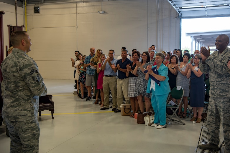 Family, friends and colleagues give Chief Master Sgt. Jim Calhoun, 23d Logistics Readiness Squadron superintendent, a standing ovation during Calhoun's retirement ceremony, June 1, 2017, at Moody Air Force Base, Ga. Calhoun entered the Air Force in August of 1991 and served in numerous positions within fuels management and logistics readiness throughout his career. (U.S. Air Force photo by Senior Airman Daniel Snider)