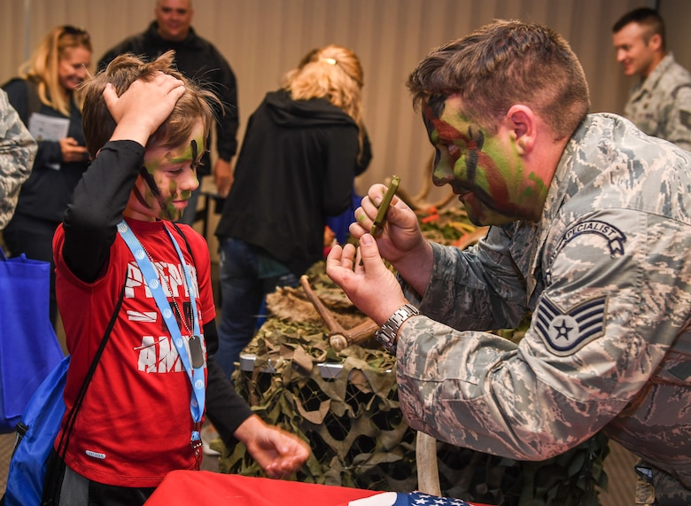 Operation Heroes is an annual event that allows children to experience a pre-departure briefing and demonstrations from more than 10 different units around base. During the event, children tasted Meals Ready-to-Eat, got their faces painted, saw Explosive Ordnance Disposal demonstrations and weapons displays.