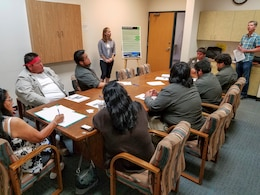 Travis Bone (right), archeologist for the U.S. Army Corps of Engineers Los Angeles District speaks with a delegation from the Colorado River Indian Tribes May 31. The Corps hosted scoping meetings to solicit stakeholder and public comment on changes to the Alamo Dam Water Control Plan.