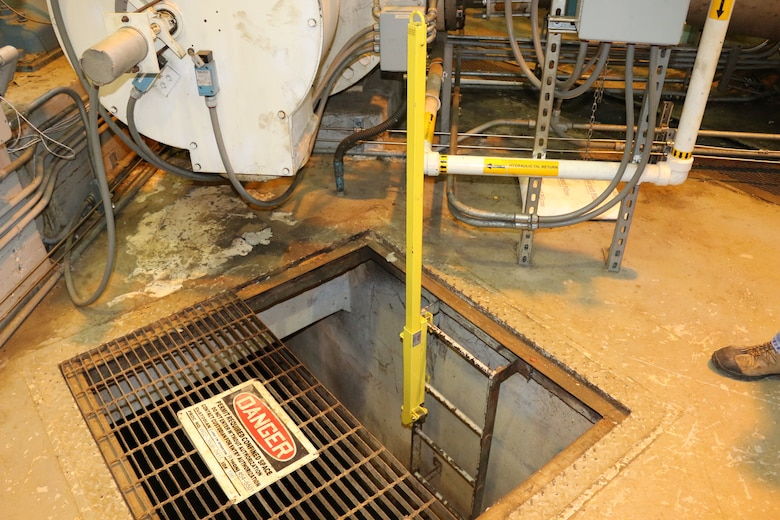 A device known as the Ladder Up allows the crew at the Arnold Air Force Base Secondary Pumping Station to more easily ascend and descend suction valve pit ladders. The use of these devices is one of several upgrades recently implemented at the Secondary Pumping Station in an effort to bolster safety and efficiency. (U.S. Air Force photo/Bradley Hicks)