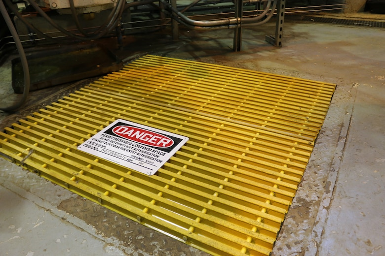 New light-weight, skid-resistant fiberglass grating now covers several suction valve pit entrances at the Arnold Air Force Base Secondary Pumping Station. These grates have replaced heavy black iron grating and are providing station crew members with easier access to the pits. The new grates are just one of several innovations recently implemented at the Secondary Pumping Station in an effort to bolster safety and efficiency. (U.S. Air Force photo/Bradley Hicks)