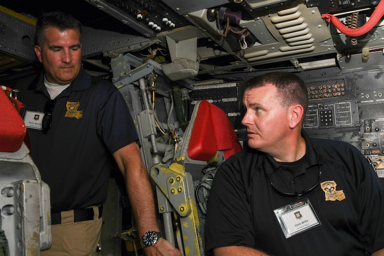 Kevin Baxter and Hack Willis, both with the Louisiana State Police, observe the interior of a B-52 Stratofortress at Barksdale Air Force Base, Louisiana, June 2, 2018.  They were on hand for the 307th Bomb Wing's Employer Appreciation Day.  Reserve Citizen Airmen of the 307th BW nominated their employers to learn more about the unit's mission.  (U.S. Air Force photo by Staff Sgt. Callie Ware/released)