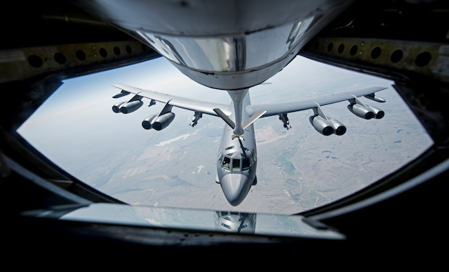 A KC-135 Stratotanker from the 92nd Air Refueling Wing at Fairchild Air Force Base, Wash. refuels B-52 Stratofortress. The refueling operation took place during Col. Ryan Samuelson, 92nd ARW/CC's final flight (U.S. Air Force photo/Senior Airman Sean Campbell)