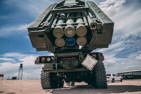 Marines with 5th Battalion, 11th Marine Regiment, 1st Marine Division, arrive at one of their launch positions with the High-Mobility Artillery Rocket System at the Air Combat Element landing strip as a part of Integrated Training Exercise 3-18 aboard the Marine Corps Air Ground Combat Center, Twentynine Palms, Calif., May 21, 2018. The purpose of ITX is to create a challenging, realistic training environment that produces combat-ready forces capable of operating as an integrated MAGTF. (U.S. Marine Corps photo by Lance Cpl. William Chockey)