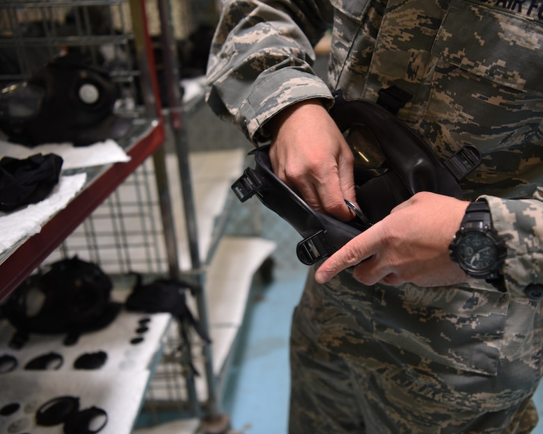 Senior Airman Tyler Marshall, 56th Logistics Readiness Squadron Individual Protection Equipment journeyman, assembles a gas mask June 4, 2018 at Luke Air Force Base, Ariz.