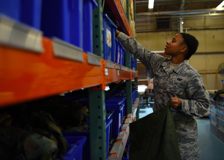 Airman 1st Class Jasmyn Marshall, 56th Logistics Readiness Squadron Individual Protection Equipment journeyman, grabs supplies for a deployment pack June 4, 2018 at Luke Air Force Base, Ariz.