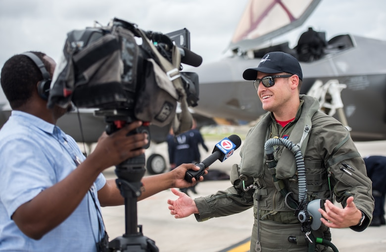 "Capt. Andrew ""Dojo"" Olson, F-35 Heritage Flight Team commander and pilot, speaks to the media during an interview at the Miami-Opa Locka Executive Airport in Opa-Locka, Fla., May 24, 2018. During the interview, Olson spoke about the capabilities of the F-35A Lightning II and what air show guests can expect to see during its performance. (U.S. Air Force photo by Airman 1st Class Alexander Cook)"