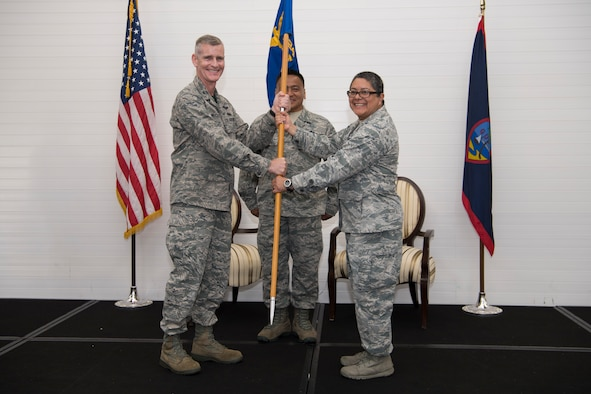 U.S. Air Force Col. Brian McCullagh, 624th Regional Support Group commander, gives Lt. Col. Carla Lugo command of the 44th Aerial Port Squadron during an assumption of command ceremony at Andersen Air Force Base, Guam, June 2, 2018.