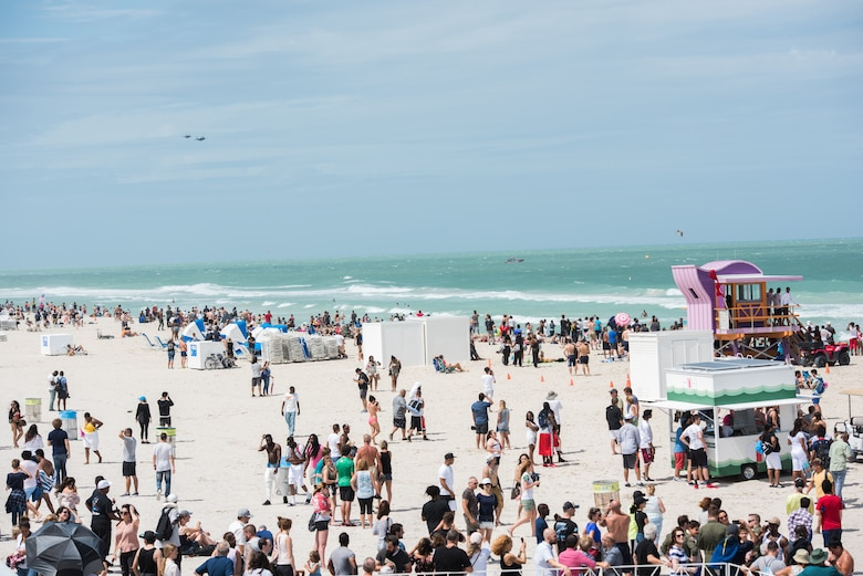 An F-35A Lightning II and F-16 Fighting Falcon fly over a crowd of air show guests during the 2018 Hyundai Air and Sea show at Miami Beach, Fla., May 27, 2018. The two-day show was held to pay tribute to military service members and first responders and honor those who have paid the ultimate sacrifice for our freedoms. (U.S. Air Force photo by Airman 1st Class Alexander Cook)