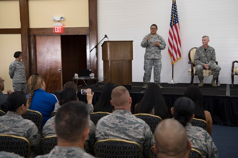 U.S. Air Force Lt. Col. Carla Lugo addresses guest and members of the 44th Aerial Port Squadron after taking command of the squadron during an assumption of command ceremony at Andersen Air Force Base, Guam, June 2, 2018.