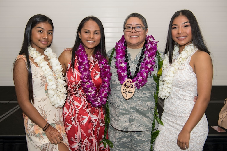 U.S. Air Force Lt. Col. Carla Lugo (center right), 44th Aerial Port Squadron commander, with her family, which include her wife, Tricia Topasna (center left) and their children, Sadie Topasna (left) and Asia Topasna (right), after an assumption of command ceremony at Andersen Air Force Base, Guam, June 2, 2018, where Lugo became the squadron commander.