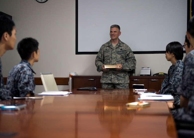 Col. Todd Wydra, 374th Maintenance Group commander, thanks Koku-Jieitai maintenance officers for visiting