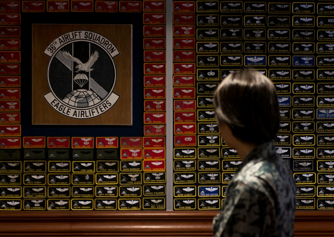 A Koku-Jieitai officer looks at a wall covered in nametags