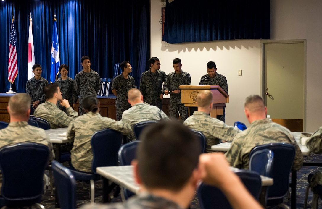 Japanese Maintenance Officers, whom recently graduated from the National Defense Academy of Japan, brief 374th Maintenance Group members