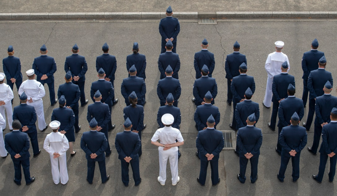 Military personnel stand in formation during a Memorial Day ceremony