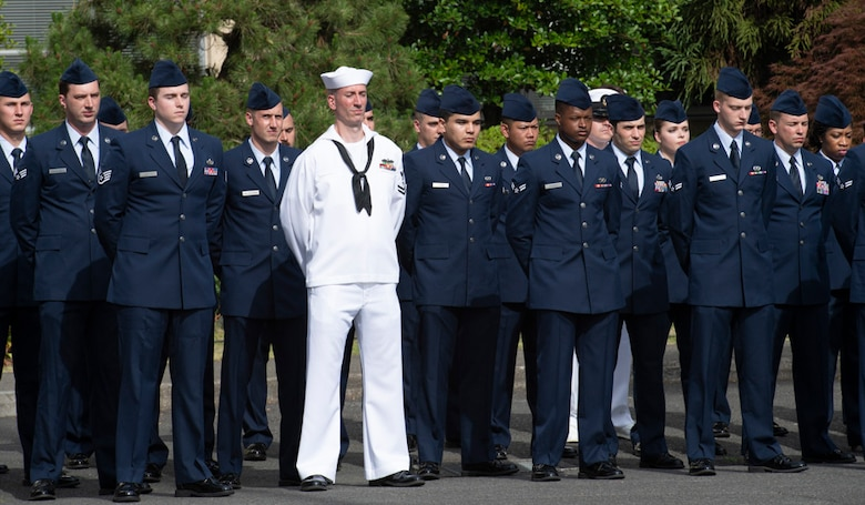 Military personnel stand in formation during a Memorial Day ceremony at Yokota Air Base