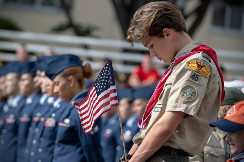 Austin Hawthorne, Boy Scouts Troop 45, prays during a Memorial Day ceremony