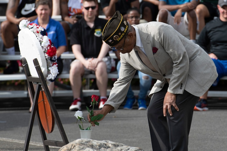 Retired U.S. Air Force Master Sgt. Ernest Richardson, a member of the Veterans of Foreign War Post 9555, places a flower during a Memorial Day ceremony