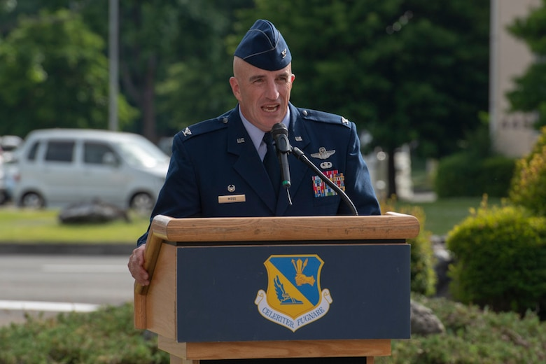 Col. Kenneth Moss, 374th Airlift Wing commander, gives a speech during a Memorial Day ceremony