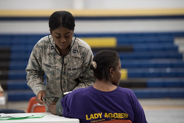 Capt. Nikita Dunbar, an Air National Guard critical-care nurse from the 187th Fighter Wing CERFP in Montgomery, Ala., takes a patient's blood pressure at the Alabama Wellness Innovative Readiness Training at Monroe County High School in Monroeville, Ala., June 3, 2018. Air Guardsmen from Alabama and Wisconsin were part of the joint force participating in the two-week training that provided no-cost health care to the citizens of lower Alabama. (US Air National Guard photo by Staff Sgt. Jared Rand)