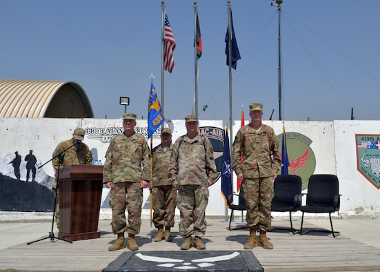 Maj. Gen. Barre Seguin (left), NATO Air Command Afghanistan and 9th Air and Space Expeditionary Task Force-Afghanistan commander, Brig. Gen. Phillip Stewart (center), outbound Train Advise Assist Command-Air and 438th Air Expeditionary Wing commander, and Brig. Gen. Joel Carey (right), inbound Train Advise Assist Command-Air and 438th Air Expeditionary Wing commander prepare for a Change of Command ceremony June 4, 2018, Kabul, Afghanistan. (U.S. Air Force photo by 1st Lt. Erin Recanzone)