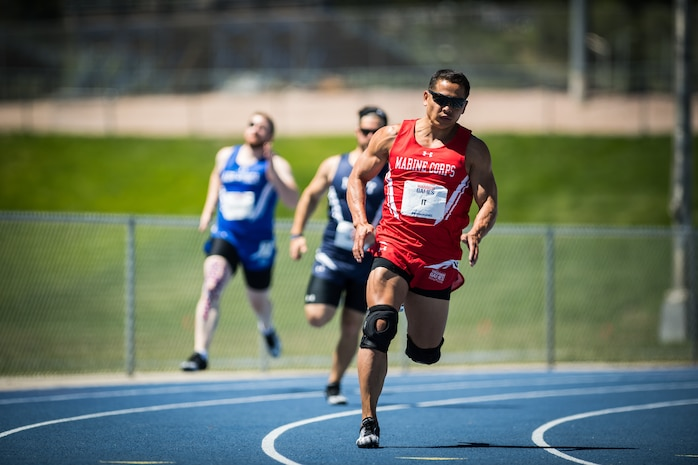U.S. Marine Corps Capt. Phal It, a native of Bronx, New York, competes in the 2018 DoD Warrior Games Track Competition at the U.S. Air Force Academy in Colorado Springs, Colorado, June 2, 2018. The Warrior Games is an adaptive sports competition for wounded, ill and injured service members and veterans. Approximately 300 athletes representing teams from the Marine Corps, Navy, Army, Air Force, Special Operations Command, United Kingdom Armed Forces, Canadian Armed Forces, and the Australian Defence Force will compete June 1 - June 9 in archery, cycling, track, field, shooting, sitting volleyball, swimming, wheelchair basketball, and - new this year - powerlifting and indoor rowing.
