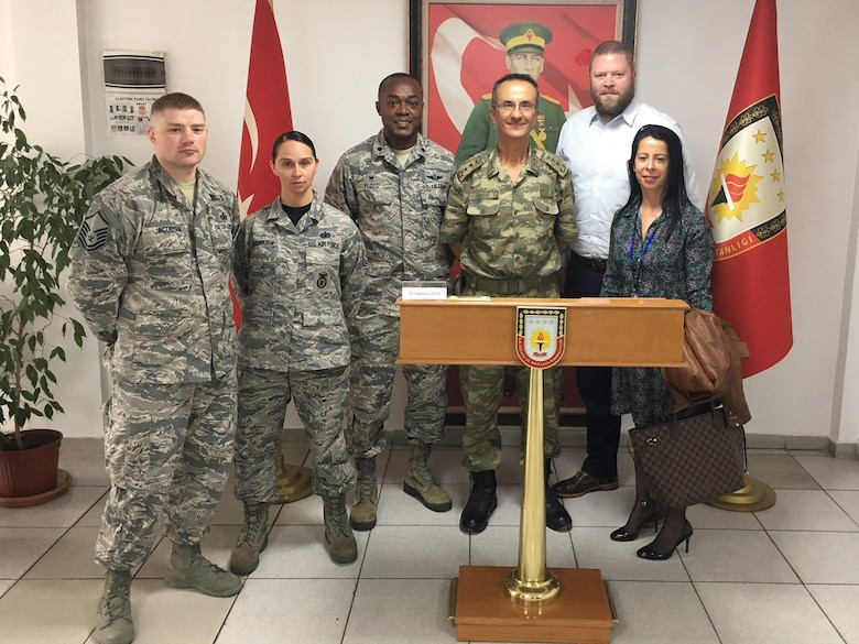 U.S. Air Force members of the 717th Air Base Squadron pose for a photo with the Turkish Education and Doctrine Base Mission Support Group commander after a joint security exercise at Ankara, Turkey, June 1, 2018.
