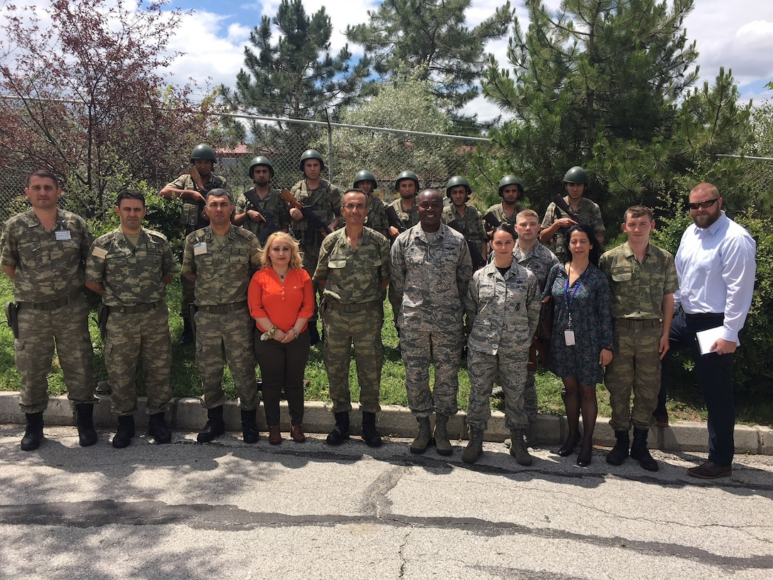 U.S. Air Force members of the 717th Air Base Squadron pose for a photo with Turkish Education and Doctrine Base Mission Support Group commander and his troops, after a joint security exercise at Ankara, Turkey, June 1, 2018.