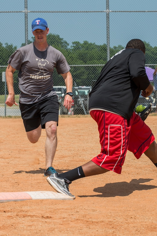 An Airmen didn't beat the throw and is out at first base during a softball game between Airmen assigned to the 307th Maintenance Squadron on June 2, 2018, Barksdale AFB, La. Airmen from the muntions sections beat their counterparts from maintenance 14-5. (U.S. Air Force photo by Master Sgt. Greg Steele/Released)