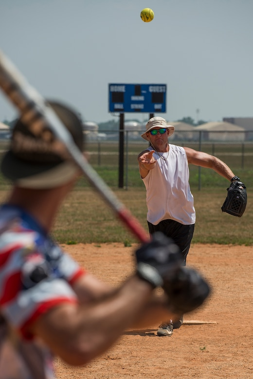 U.S. Air Force Chief Master Sgt. Kyle Graff throws a pitch to a member of the 307th Maintenance Squadron munitions section during a squadron softball game on June 2, 2018, Barksdale AFB, La. The game pitted munitions against maintainers, with munitions winning 14-5. (U.S. Air Force photo by Master Sgt. Greg Steele/Released)