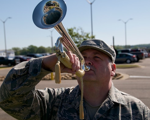 Tech. Sgt. John Rhoden, a functional assistant manager with the 186th Logistics Readiness Squadron, demonstrates how to play a bugle at Key Field Air National Guard Base, Meridian, Miss., April 8, 2018.
