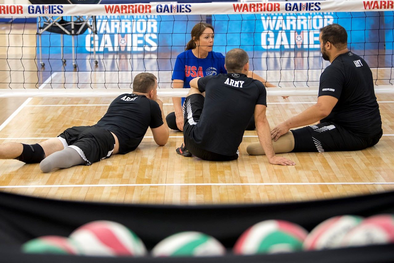 USA Volleyball and Team Army Coach Linda Gomez gives instructions to members of her team during practice for the 2018 Defense Department Warrior Games at the U.S. Air Force Academy in Colorado Springs, Colo., June 1, 2018. DoD photo by EJ Hersom
