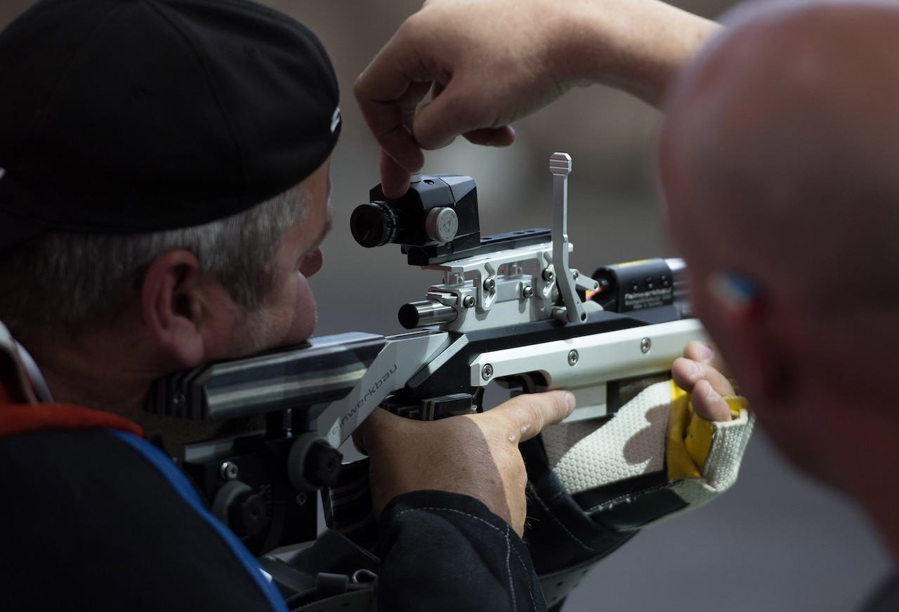 Kevin Nanson of Team Canada makes adjustments to his rifle with assistance from his coach during shooting practice at the 2018 Defense Department Warrior Games at the U.S, Air Force Academy in Colorado Springs, Colo., May 30, 2018. DoD photo by Staff Sgt. Carlin Leslie