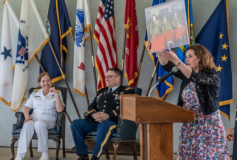 Kristen Farrand, wife of retiring Army Col. Dale Farrand, speaks at his retirement ceremony May 31