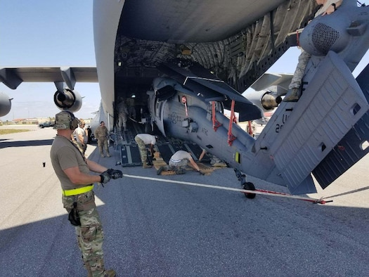 Reserve Citizen Airmen from the 920th Aircraft Maintenance Squadron at Patrick AFB, Fla. load an HH-60G Pave Hawk onto a C-17 as part of Red Flag-Rescue 18-2 near Davis-Monthan Air Force Base, Ariz., on May 3, 2018. Red Flag-Rescue gives joint service personnel an opportunity to build fundamental combat search and rescue skills to fight in and out of contested environments. (U.S. Air Force photo by Capt. Jonathan Foster)