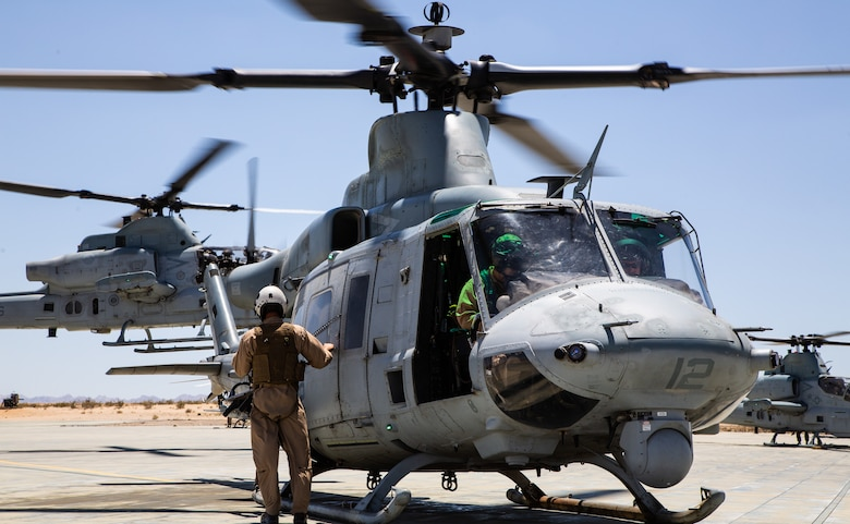 A crew with Light Attack Helicopter Squadron 367, also known as 'Scarface', prepares a UH-1Y Venom Utility helicopter for a flight mission during the Final Exercise of Integrated Training Exercise 3-18 aboard the Marine Corps Air Ground Combat Center, Twentynine Palms, Calif., May 23, 2018. Marine aviation provides the Marines of the Marine Air Ground Task Force the operational flexibility it needs to accomplish their mission. (U.S. Marine Corps photo by Lance Cpl. Dave Flores)