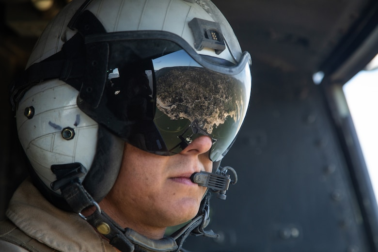 A doorgunner with Light Attack Helicopter Squadron 367, also known as 'Scarface', enjoys the view of Big Bear, Calif., while on a flight mission during the Final Exercise of Integrated Training Exercise 3-18 aboard the Marine Corps Air Ground Combat Center, Twentynine Palms, Calif., May 23, 2018. Marine aviation provides the Marines of the Marine Air Ground Task Force the operational flexibility it needs to accomplish their mission. (U.S. Marine Corps photo by Lance Cpl. Dave Flores)