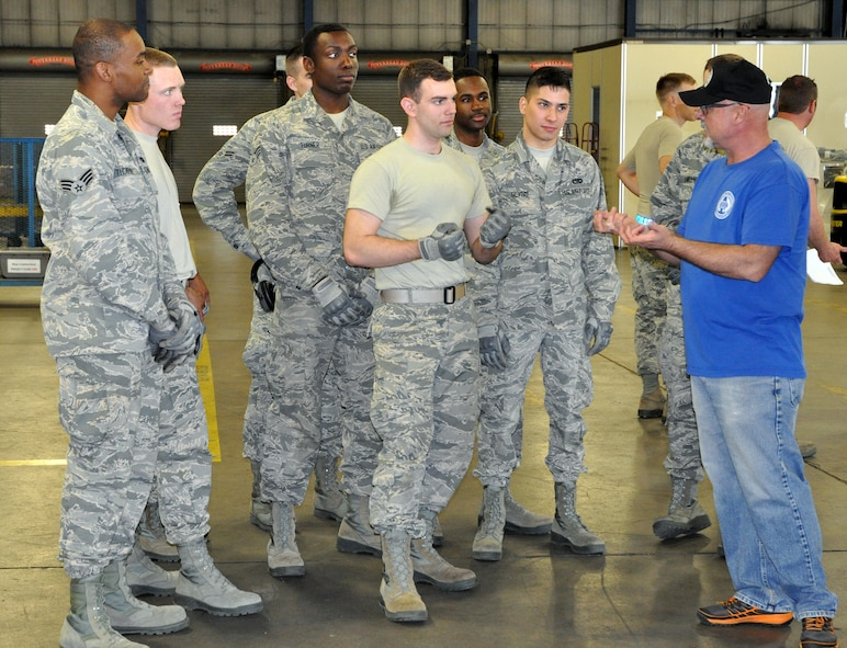 Retired Senior Master Sgt. Richard Warren gives feedback to a team of 87th Aerial Port Squadron Reserve Citizen Airmen following a hands-on training event during the Port Dawg Challenge, May 5, 2018. (U.S. Air Force photo/2nd Lt. Rachel N. Ingram)